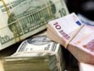 Доллар подешевел в начале дня на 12 коп., евро - на 6 коп.