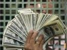Доллар на закрытии торгов упал на 35 копеек, опустившись ниже 32 рублей, евро потерял 40 копеек